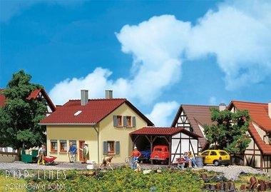 Buitenhuis met aanbouw