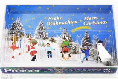 Kerstman met kinderen en sneeuwpop